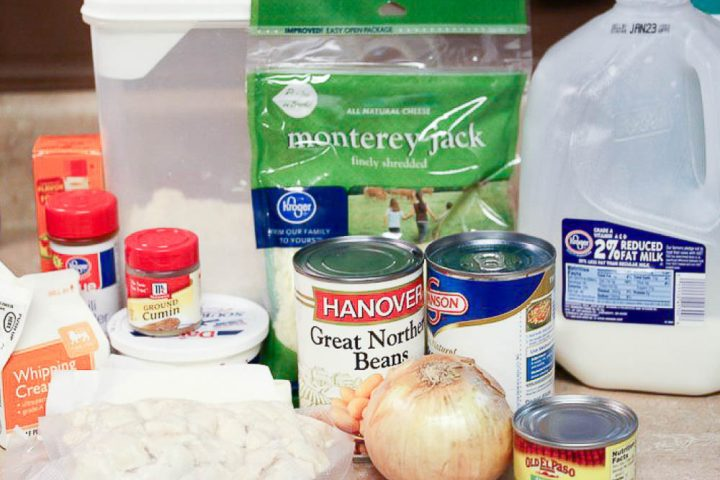 Ingredients for Creamy White Chicken Chili: whipping cream, flour, onion, Great Northern Beans, chicken broth, milk, Tabasco sauce, chili powder, ground cumin, green chilies, cooked, diced chicken, shredded Monterey Jack cheese, and sour cream