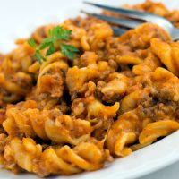 Spiral pasta with ground beef in a tomato cheese sauce