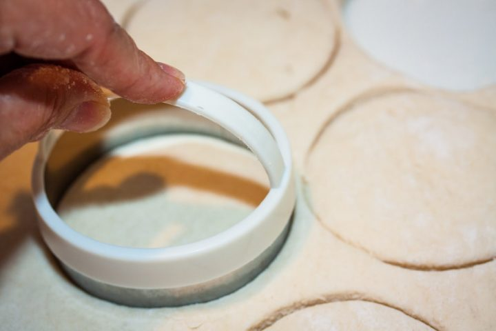 Biscuits being cut out of rolled dough