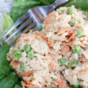 Veggie rice salad with chicken served on lettuce leaves
