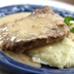 Cube steak and mashed potatoes smothered with gravy