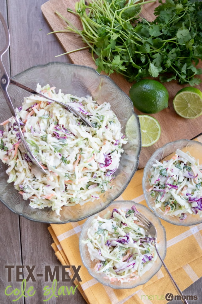 Overhead shot of a large serving bowl of coleslaw with two smaller filled salad dishes and limes and cilantro tothe side; text Tex-Mex Coleslaw Add Salt & Serve