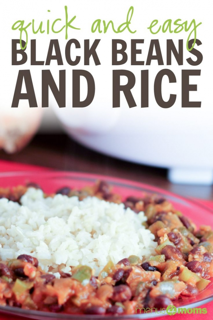 Black Beans and Rice on a glass plate sitting on a table with a red tablecloth