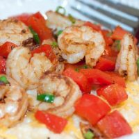 Shrimp and Red Pepper over Cheese Grits in a bowl