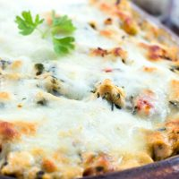 Cheese-covered casserole garnished with parsley