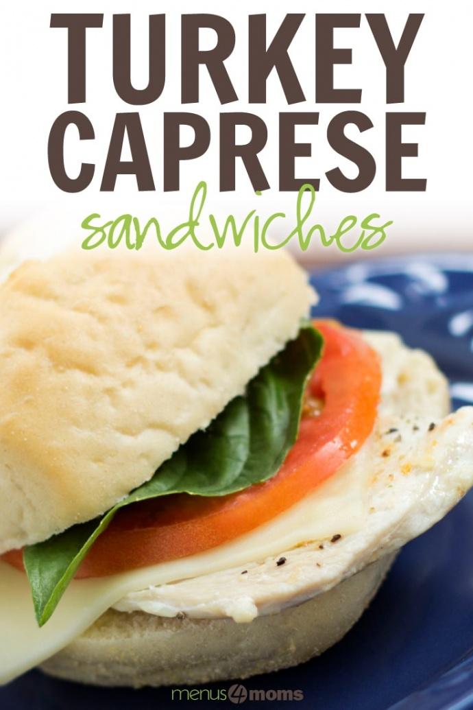 Turkey slice with mozzarella cheese, tomato, and basil on a white sandwich roll with text Turkey Caprese Sandwich Add Salt & Serve