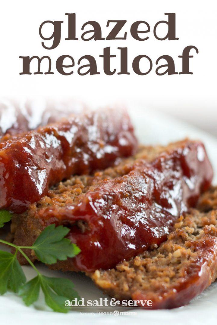 Slices of glazed meatloaf on a white plate. Text Glazed Meatloaf Add Salt & Serve formerly menus4moms