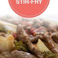 Cooked strips of beef with onions, brocolli florets, diced tomatoes, and mushrooms on a bed of rice; text Beef Vegetable Stir-fry - Add Salt & Serve logo