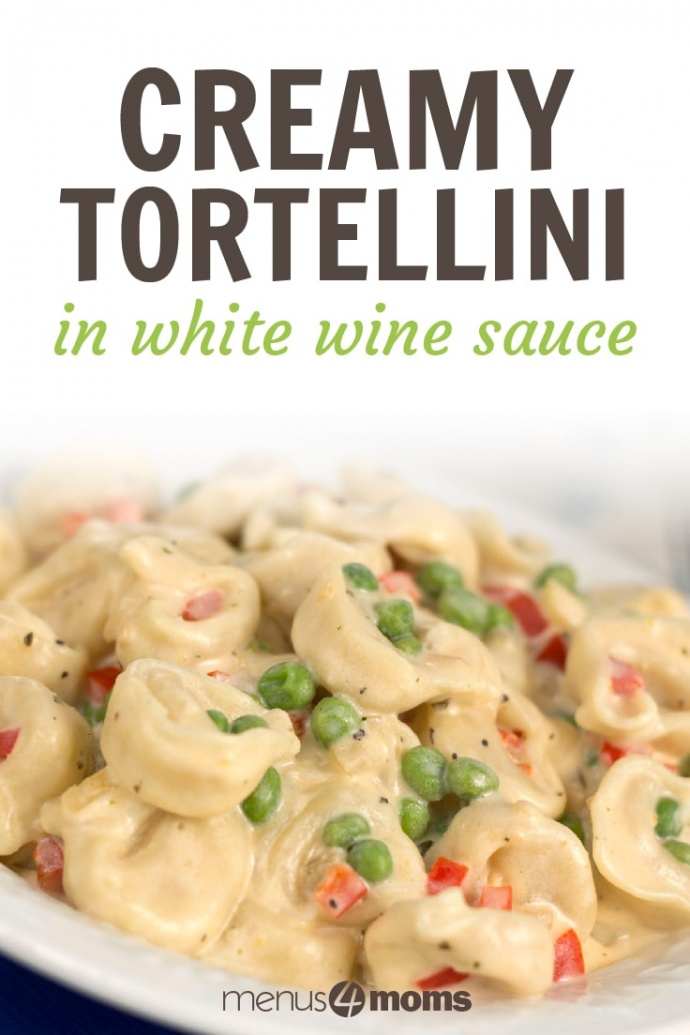 Blue platter with white plate full of tortellini covered in a white wine sauce, green peas, diced red bell pepper, and basil; text Creamy Tortellini in white wine sauce Add Salt & Serve