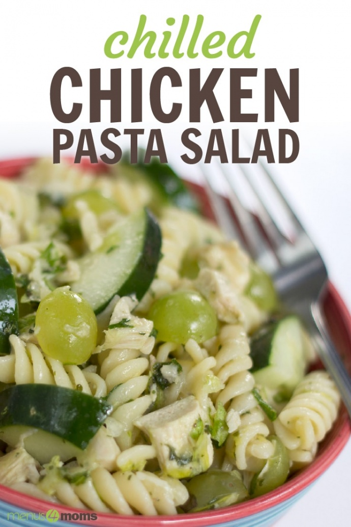 Bowl full of spiral pasta, diced chicken, grapes cut in half, and cucumber slices. There is a fork in the bowl; text Chilled Chicken Pasta Salad Add Salt & Serve