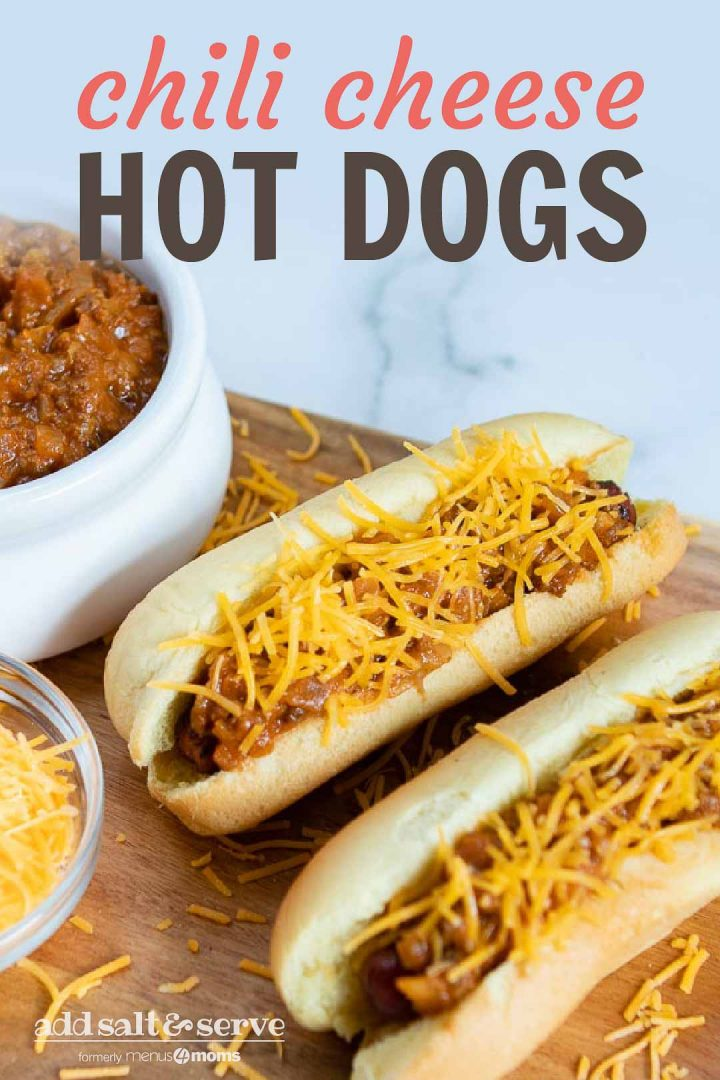 Two hot dogs in buns topped with chili and shredded cheese, a bowl of shredded cheese, and a bowl of chili. Text Chili Cheese Hot Dogs Add Salt & Serve formerly Menus4Moms