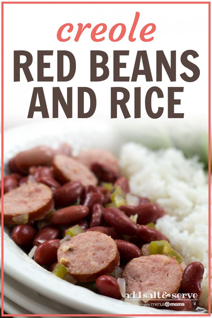 Slices of smoked sausage mixed with red beans, diced onions, and diced green bell pepper, beside a serving of rice. The food is in a white bowl with a fork and garnished with a sprig of parsley. Text Red Beans and Rice Add Salt & Serve formerly Menus4Moms