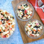 Overhead view of three bowls of Apple Raisin Salad