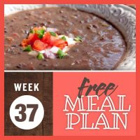Week 37 Free Meal Plan with sideview of thick black bean soup garnished with sour cream, chopped red onion, chopped tomato, and diced jalapeno pepper