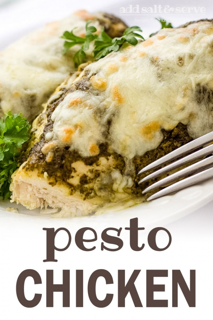 White plate with two chicken breasts topped with pesto and melted mozzarella cheese, garnished with parsley. There is a fork on the edge of the plate; text add salt & serve formerly menus4moms pesto chicken