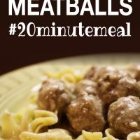 Yellow bowl with egg noodles covered in meatballs with cream sauce and text Swedish Meatballs #20minutemeal