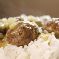 Meatballs with bits of pineapple served over white rice