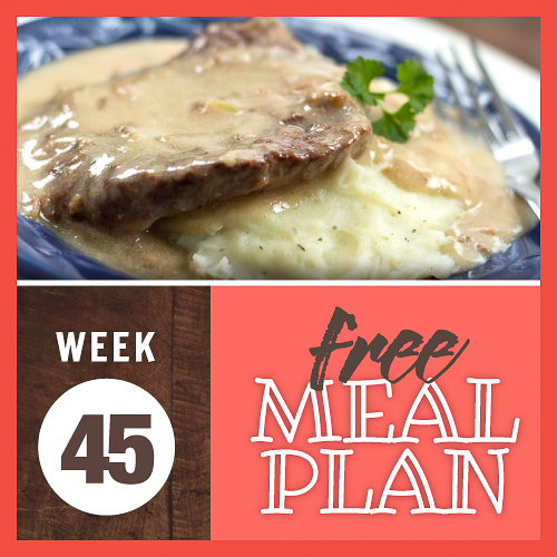 Image of cube steak and mashed potatoes smothered in gravy on a plate with a fork and text Week 45 free meal plan