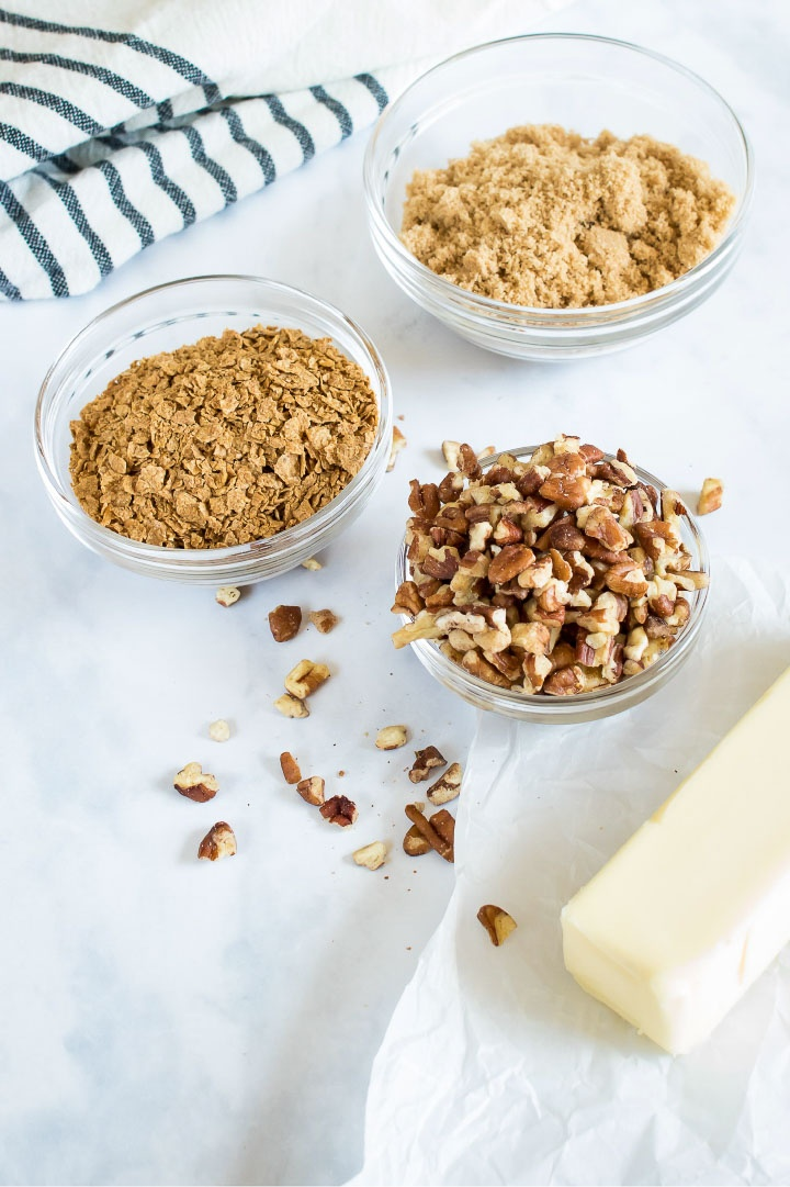 Streusel topping ingredients: melted butter, brown sugar, chopped pecans, and crushed cereal