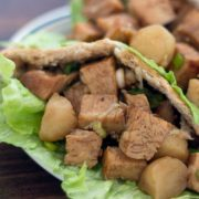 Diced chicken in a lettuce-lined pita on a white plate