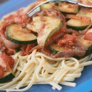 Linguini in a tomato sauce with sliced zucchini