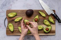 peeling avocado quarters